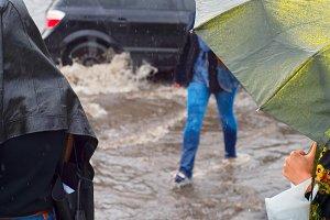 Women urban road heavy rain