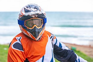 the rider wears a protective helmet