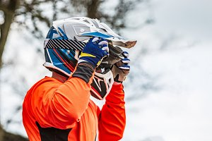 rider wears a protective helmet