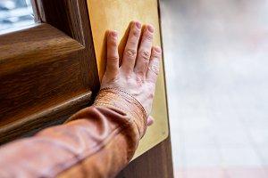 Hand opening the door.