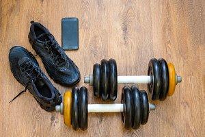 Gym equipment on wooden background