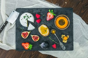 Appetizer set. Cheese, fruit, honey