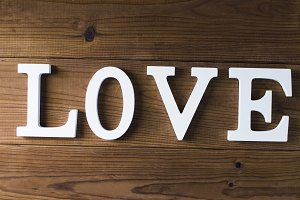 love in letters on a wooden background