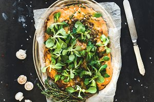 Homemade pizza with lamb's lettuce