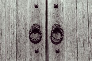 wooden door with forged handles
