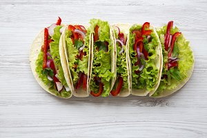 Vegetarian tacos on white wooden
