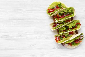 Fresh vegetarian tacos on wooden