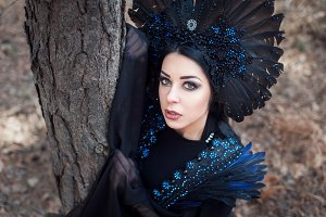 Portrait of a beautiful mysterious woman in the forest