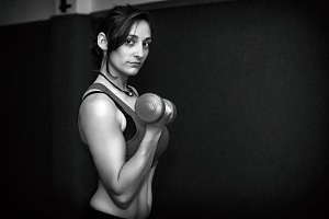 Athletic woman with weights