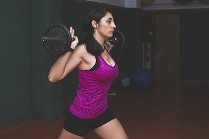 thletic woman with weights