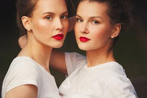 two beautiful girls with red lips