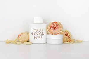 Cosmetics mockup with roses, bottle