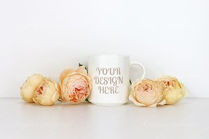White coffee mug mockup with roses