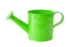Green watering can, isolated.
