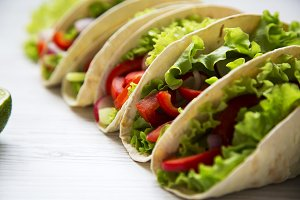 Fresh vegetarian tacos on white
