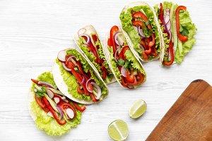 Fresh vegetarian tacos on white