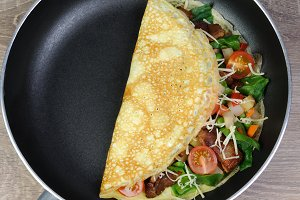 Omelette with vegetables and cheese