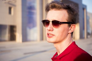 close up brutal young male in casual clothes portrait walking in the city
