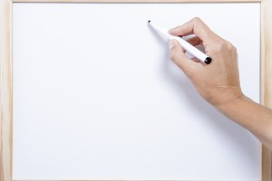 hand writing on a whiteboard