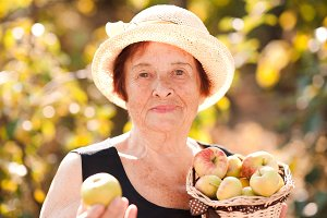Senior woman with fruits