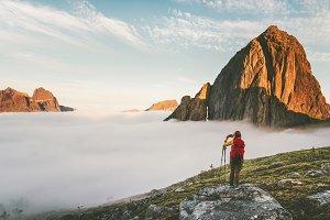 Backpacker exploring sunset mountain