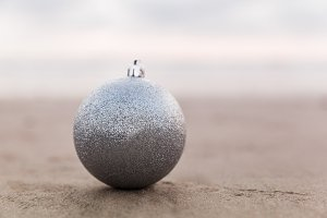 Silver Christmas Ball At The Beach