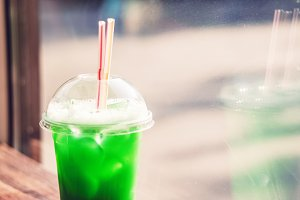 green cocktail with ice. The sour and thirst-quenching drink in summer weather