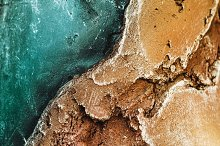stone. Texture of relief stone with a golden hue and sea color. wallpaper and background. horizontal by  in Abstract