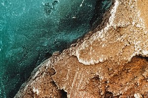 stone. Texture of relief stone with a golden hue and sea color. wallpaper and background. panorama