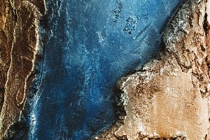 a rock. background and texture. blue color and shades of gold. wallpaper