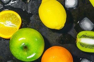 fruit and ice. Black background