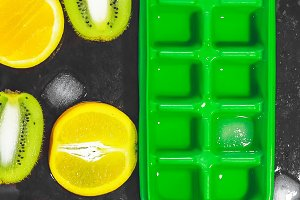 empty form for ice. fresh fruits. Black background. ice cubes