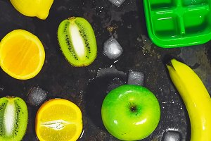 fruits and ice cubes. Form for ice. refreshing fruit. summer