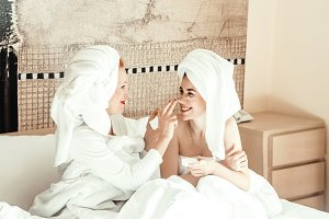mom and daughter are happy together. time for girls. body care. family and love