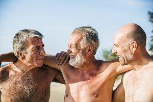 Senior friends having fun on beach