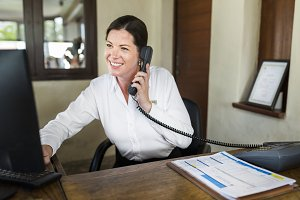 Female resort receptionist working