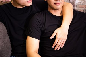 Asian gay couple spending time together at vintage home. Portrait of happy gay men - Homosexual love concept