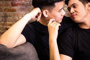 Asian gay couple looking at each other together at vintage home. Portrait of happy gay men - Homosexual love concept