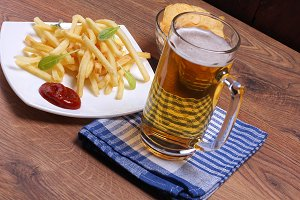 Beer mug and plate of food
