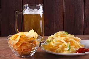 Beer glass and plate of food