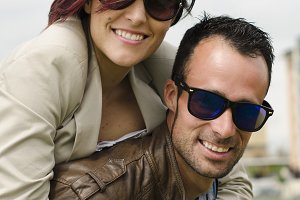 Smiling sunglasses couple