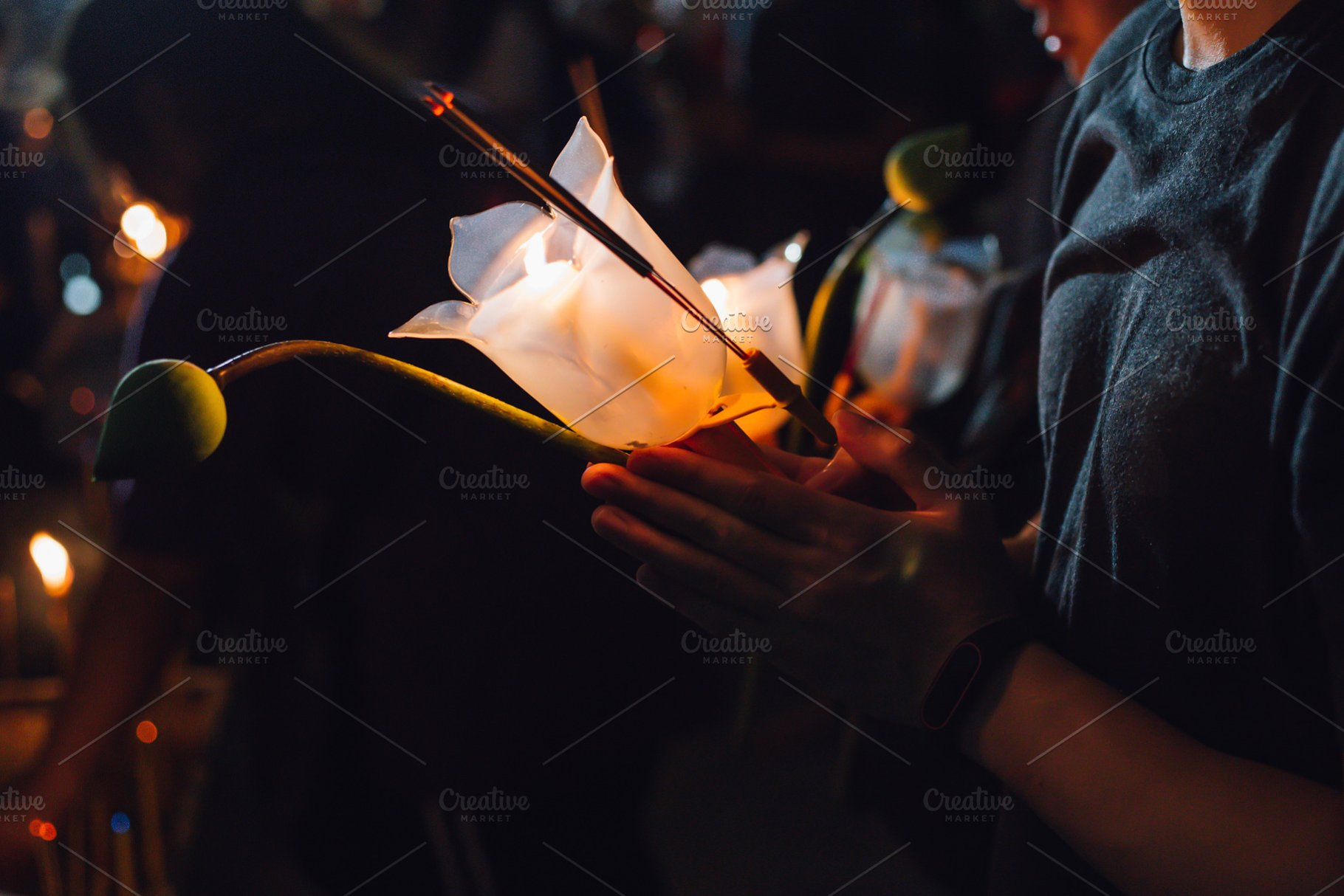Buddhist praying with incense sticks, lotus flower and candles on holy  religion day of Vesak at night