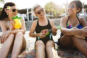 Senior friends having fun at beach
