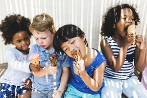 Little kids eating yummy ice cream