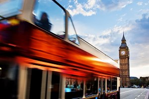 Red bus in motion & Big Ben, London