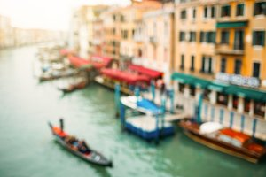Blurred view on buildings and channel in Venice.