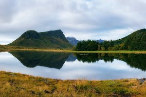 Lake with a mountain reflection on Lofoten islands in Norway