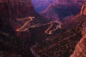 Road in Zion National Park with car light trails