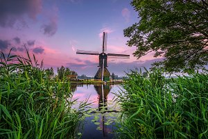 Old dutch windmill at sunset in Kinderdijk, Netherlands