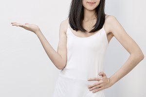 Happy beautiful asian woman presenting copyspace